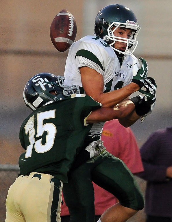 . Bonita\'s Josh Peiffer (15) defends as he knocks the ball out of Bonita\'s Dimas Diaz (13) hands in the first half of a prep football game at Covina District Field in Covina, Calif. on Friday, Sept. 6, 2013.   (Photo by Keith Birmingham/Pasadena Star-News)
