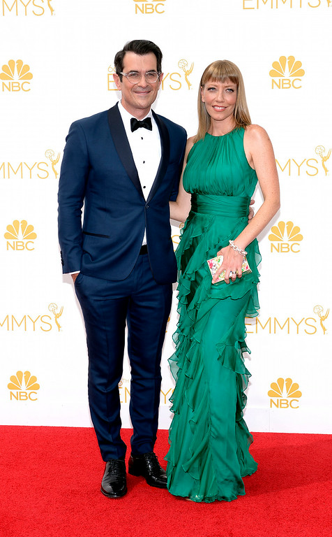 . Ty Burrel and Holly Anne Brown on the red carpet at the 66th Primetime Emmy Awards show at the Nokia Theatre in Los Angeles, California on Monday August 25, 2014. (Photo by John McCoy / Los Angeles Daily News)