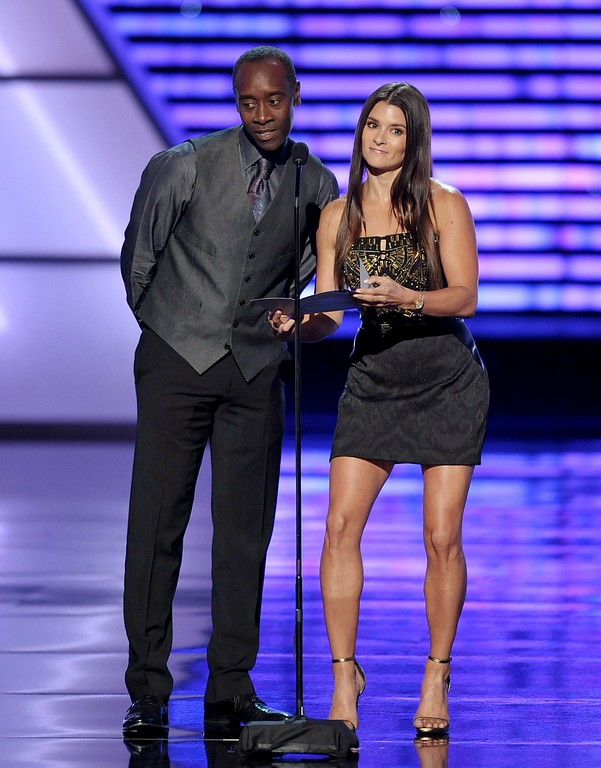 . Don Cheadle, left, and Danica Patrick speak on stage at the ESPY Awards on Wednesday, July 17, 2013, at Nokia Theater in Los Angeles. (Photo by John Shearer/Invision/AP)