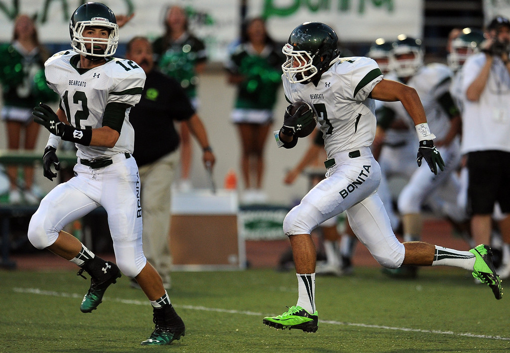 . Bonita\'s Jacob Karim (C) (7) recovers a San Dimas fumble and runs for a touchdown as teammate Danny Gelalich (12) looks on in the first half of a prep football game at Citrus College on Thursday, Aug. 29, 2013 in Glendora, Calif.   (Keith Birmingham/Pasadena Star-News)