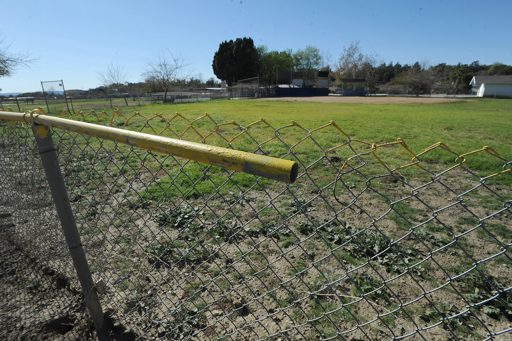 . A fence in center field in one of the diamonds. A lawsuit is being filed over the Sylmar baseball field, which is accused of being mismanaged by the operators. Lawsuit alleges that the grounds have been neglected. Sylmar, CA. February 1, 2014 (Photo by John McCoy / Los Angeles Daily News)