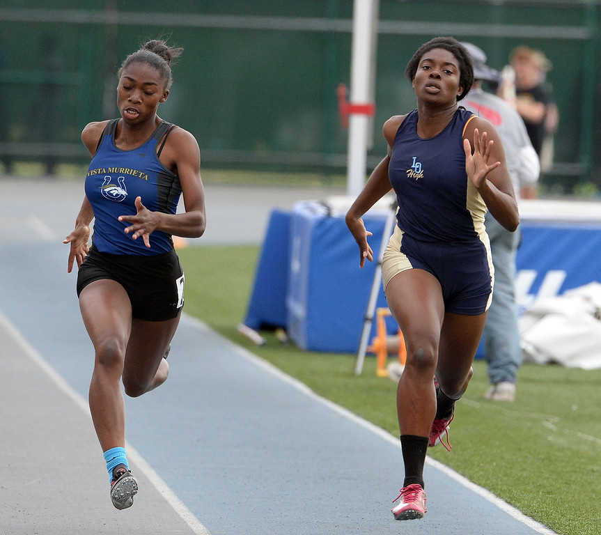 . Los Osos\' Aminat Iriafen competes in the division 1 200 meters race during the CIF Southern Section track and final Championships at Cerritos College in Norwalk, Calif., Saturday, May 24, 2014. 