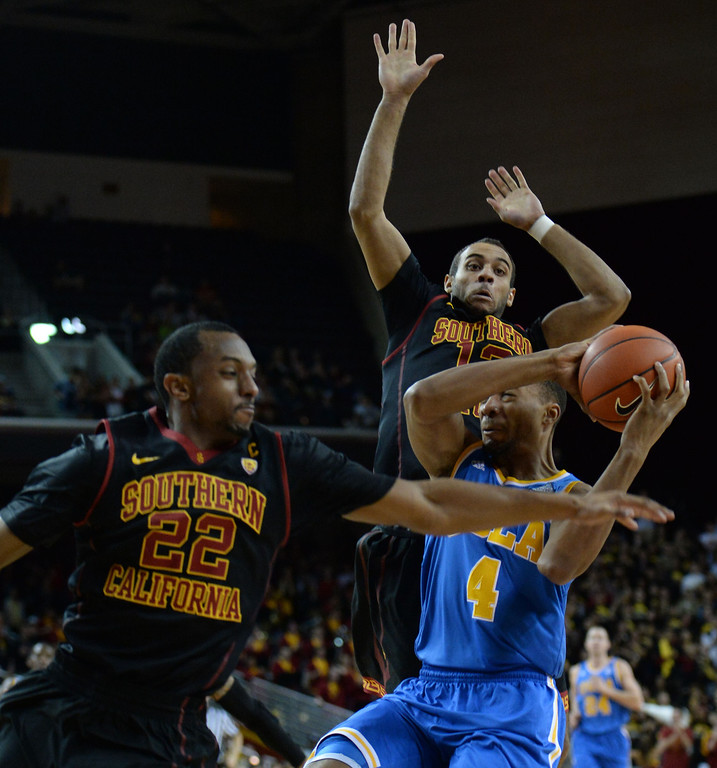 . Southern California\'s Byron Wesley, (22) defends against UCLA\'s Norman Powell (4) in the first half of a PAC-12 NCAA basketball game at Galen Center in Los Angeles, Calif., on Saturday, Feb. 8, 2014. (Keith Birmingham Pasadena Star-News)