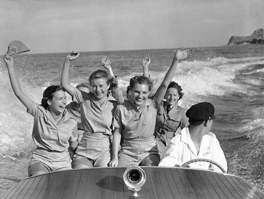 . After spending most of the day in a demonstration of their training, members of the Women�s Ambulance and Defense Corps of America went for a speedboat ride at Santa Catalina Island, July 28, 1941, where their maneuvers were conducted on July 27. The women volunteers study fire and air raid warden instruction, first aid ambulance driving and mechanics, field radio and signal corps activities, and physical education. (AP Photo/Ed Widdis)