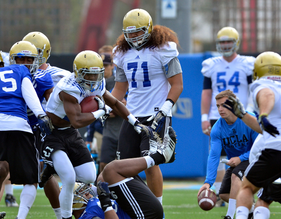 . UCLA football spring practice at Spaulding Field.  #71 OL Poasi Moala. (Apr.16, 2014 Photo by Brad Graverson/The Daily Breeze)