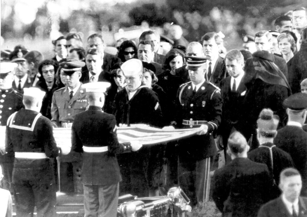 . President John F. Kennedy was buried in Arlington National Cemetery on November 25, 1963. His widow Jackqueline, stands with Robert Kennedy.   Los Angeles Daily News file photo