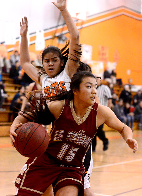 . South Pasadena\'s Lexie Scholtz (13) attempts to stop La Canada\'s Keilee Bessho (15) as South Pasadena defeats La Canada 66-58 Friday night, January 31, 2014 at South Pasadena High School. (Photo by Sarah Reingewirtz/Pasadena Star-News)