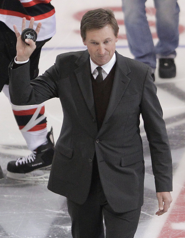 . NHL Hall of Fame player Wayne Gretzky waves to the crowd after dropping the official puck before the start of Game 3 of the Stanley Cup Finals between the Los Angeles Kings and New Jersey Devils, Monday, June 4, 2012, in Los Angeles.  (AP Photo/Jae C. Hong)