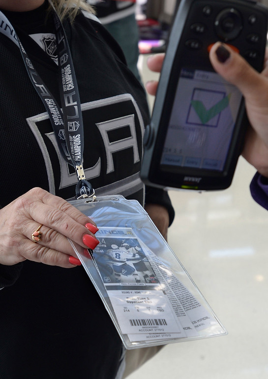 . Fans get their tickets scanned as they enter Staples Center before the Los Angeles Kings faced the New York Rangers in game 1 of the Stanley Cup Finals. Los Angeles, CA. 6/4/2014(Photo by John McCoy / Los Angeles Daily News)