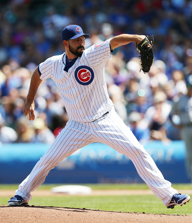 . CHICAGO, IL - AUGUST 04: Carlos Villanueva #33 of the Chicago Cubs pitches against the Los Angeles Dodgers during the first inning on August 4, 2013 at Wrigley Field in Chicago, Illinois.  (Photo by Jonathan Daniel/Getty Images)