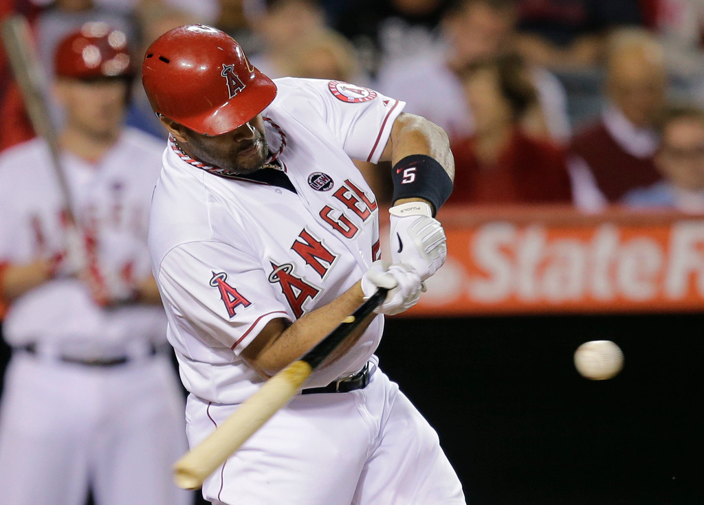 . Los Angeles Angels\' Albert Pujols hits a home run during the eighth inning of a baseball game against the Seattle Mariners in Anaheim, Calif., Tuesday, June 18, 2013. (AP Photo/Jae C. Hong)