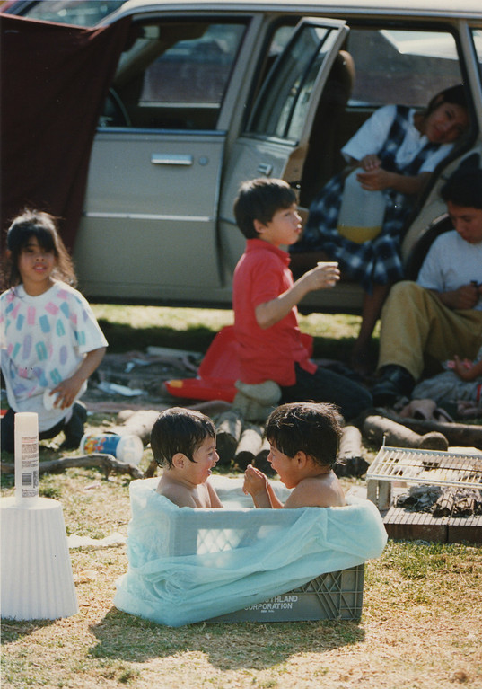 . Children bathe in a milk crate at Lanark Park. Canoga Park, CA. 1/17/1994, photo by (John McCoy/Los Angeles Daily News)