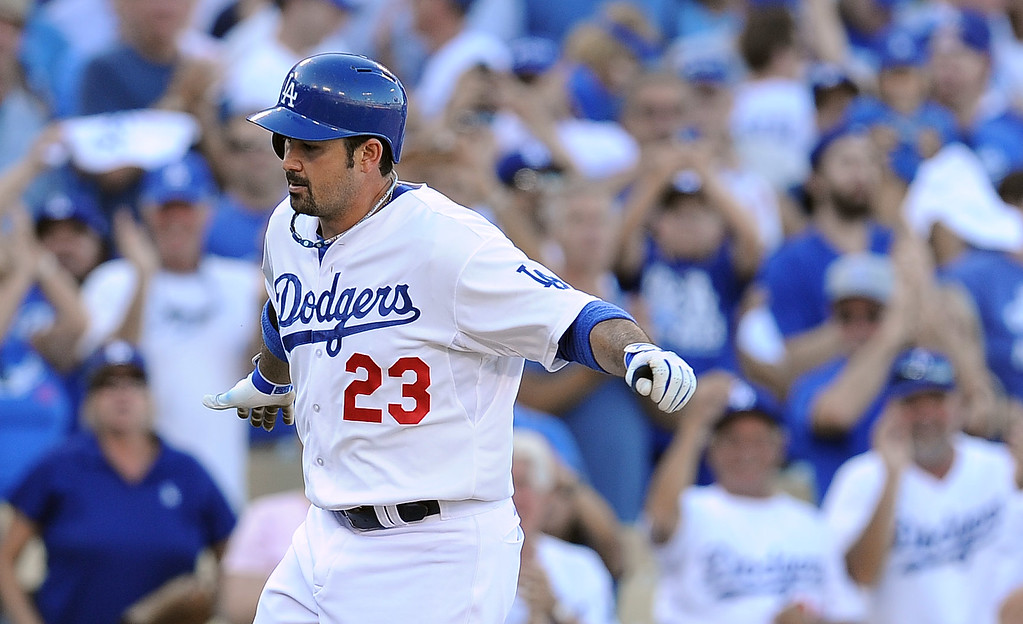 . The Dodgers\' Adrian Gonzalez rounds the bases after his homer in the 8th during game 5 of the NLCS against the Cardinals at Dodger Stadium Wednesday, October 16, 2013. The Dodgers beat the Cardinals 6-4. (Photo by Hans Gutknecht/Los Angeles Daily News)
