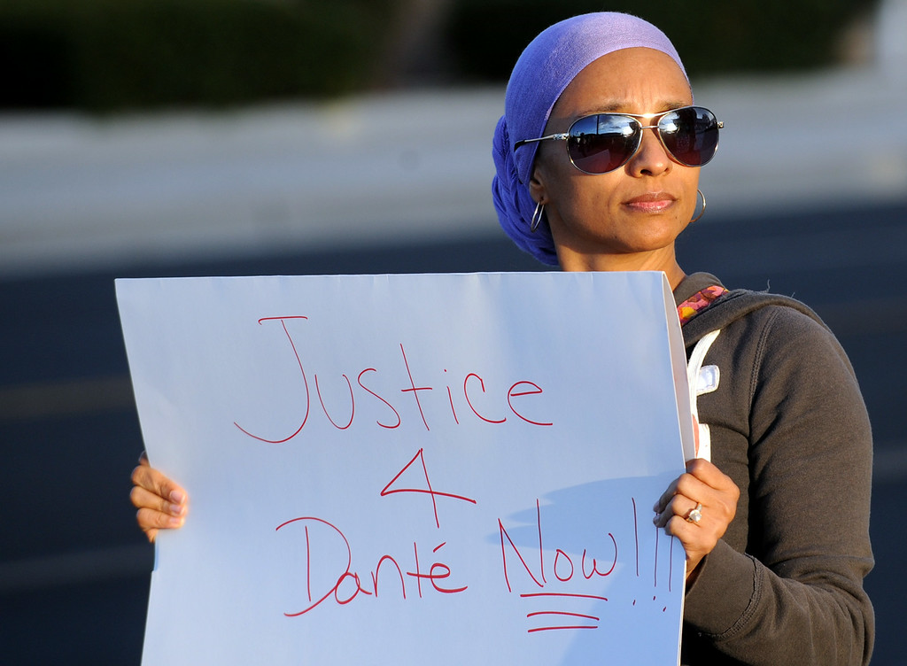 . Laura Sands, 47, of Spring Valley Lake, participates in a protest against police brutality in honor of Dante Parker on Wednesday, August 20, 2014 in Victorville, Ca.  The protest was organized by CopsWatch IE and drew about thirty people. (Photo by Micah Escamilla/The Sun)