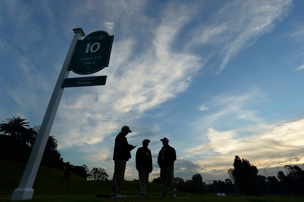 . Marshals gathered on the 10th tee box in the early morning hours before the final round of the Northern Trust Open. Pacific Palisades, CA. February 16, 2014 (Photo by John McCoy / Los Angeles Daily News)