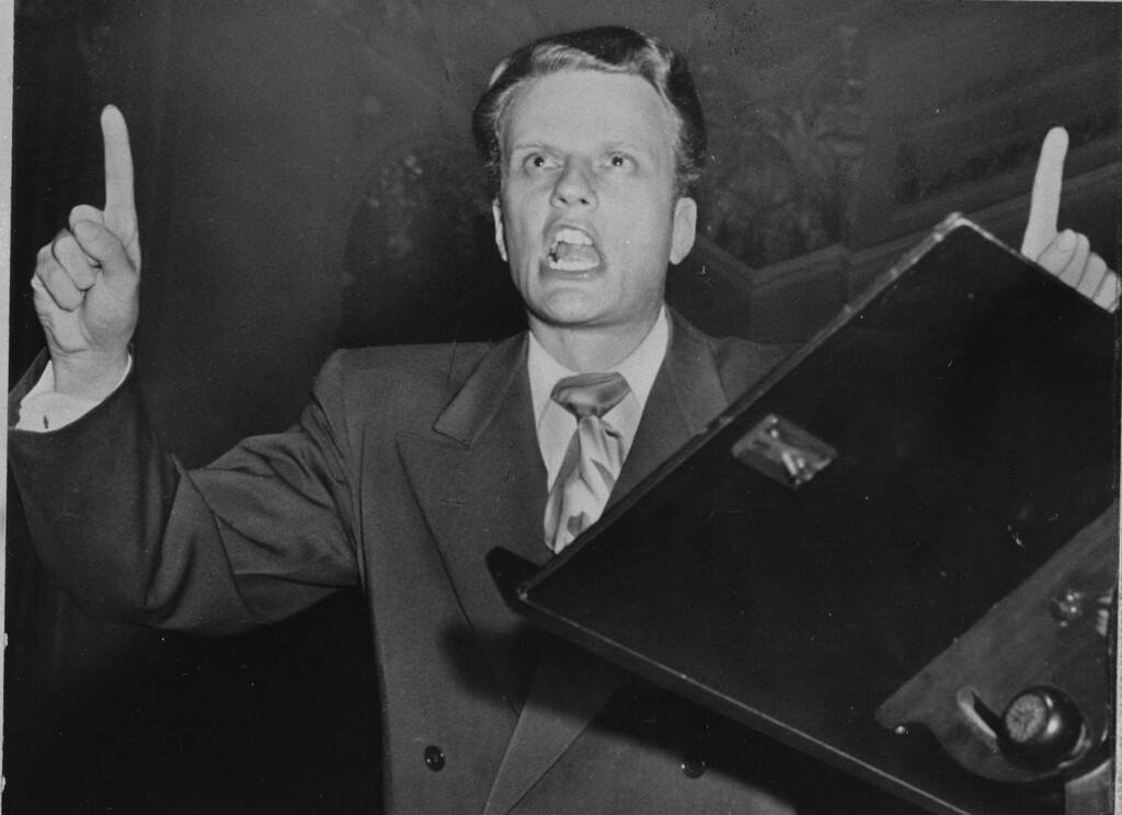 . Evangelist Billy Graham is shown March 29, 1950 at Portland, Maine.      (AP Photo)