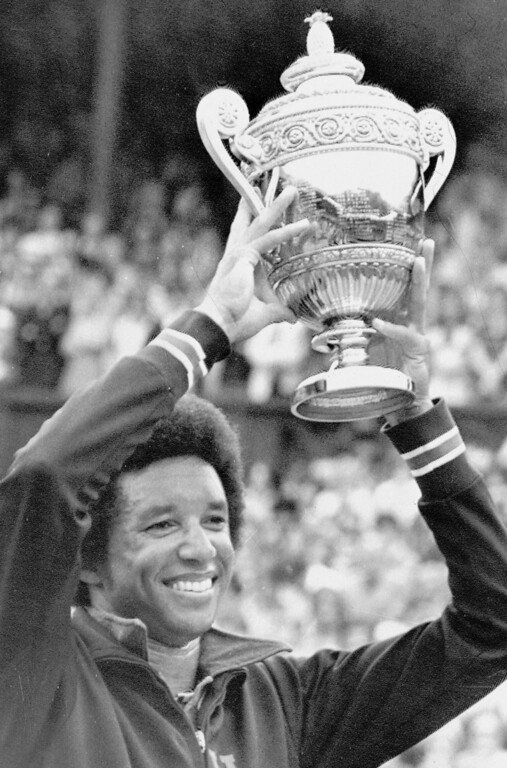 . Arthur Ashe of Richmond, Va., the new men\'s singles champion, holds the trophy aloft after defeating former title holder Jimmy Connors in the all-England Lawn Tennis Championships at Wimbledon, July 5, 1975.  (AP Photo)