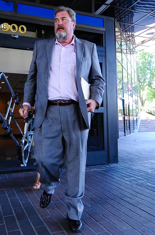 . Recall proponent Scott Beard leaves City Hall after delivering recall petitions to City Clerk Gigi Hanna at San Bernardino City Hall on Thursday, Aug. 22, 2013. On Thursday, San Bernardino County Superior Court Judge David Cohn ordered Hanna to count the petitions to recall City Attorney James F. Penman and several City Council members. (Rachel Luna / Staff Photographer)