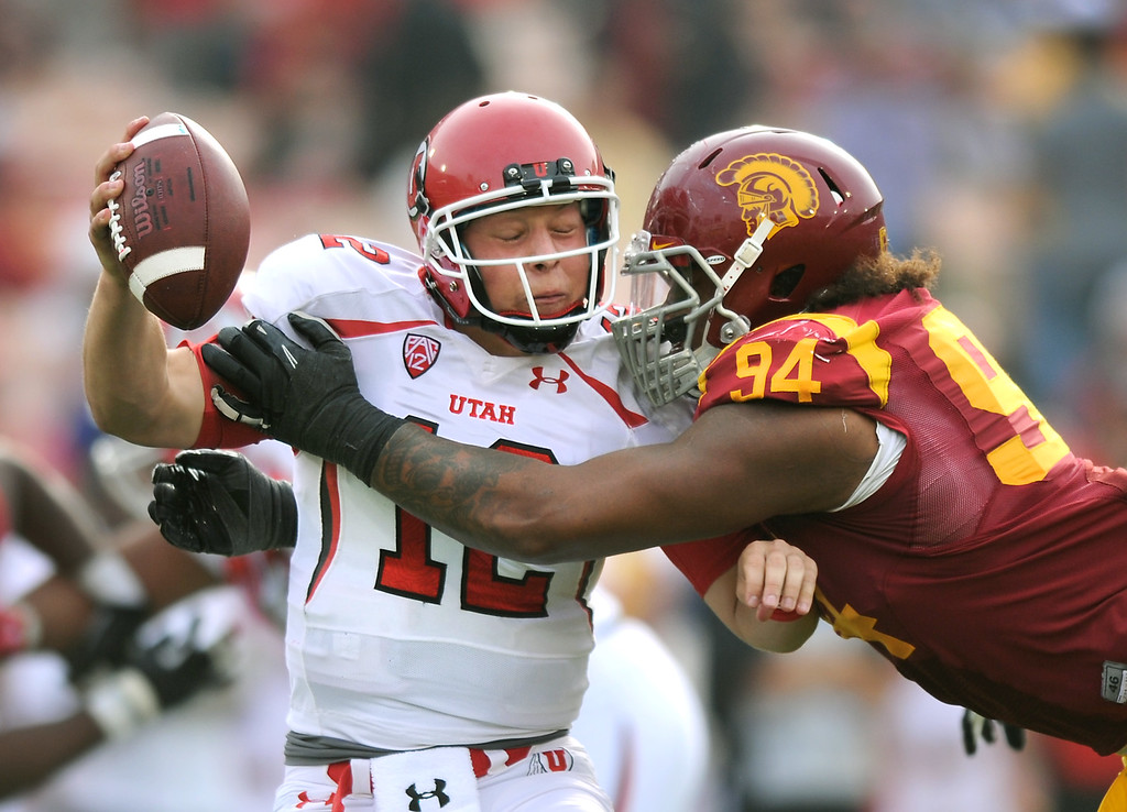 . USC\'s Leonard Williams sacks Utah QB Adam Schulz in the fourth quarter, Saturday, October 26, 2013, at the L.A. Memorial Coliseum. (Michael Owen Baker/L.A. Daily News)