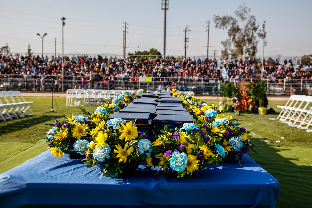 . The diplomas, parents, family and friends are ready for the graduation to begin, at John H Francis Polytechnic High School, Sun Valley, Calif., June 7, 2013. Photo: Lynn Levitt.