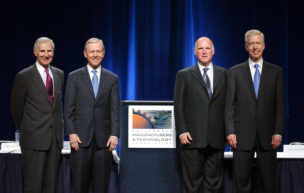 . Former California Governors George Deukmejian, Pete Wilson, Jerry Brown, and Gray Davis, left, to right, stand together on stage after appearing at the California Manufacturers and Technology Association summit in Sacramento, Calif., on Wednesday, June 23, 2004. The  four former Governors each hosted a panel discussion on issues  concerning the business and manufacturing enviornment in California.(AP Photo/Hand-out photo/Steve Yeater-CMTA)