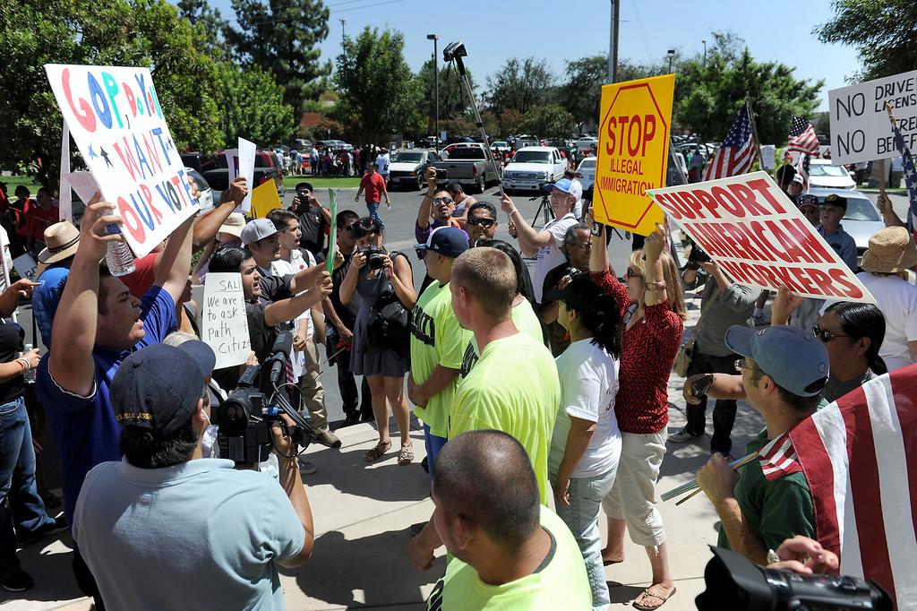 ". Marchers from the ""Caravan for Citizenship\"" face off agaist counter-protesters outside Congressman Kevin McCarthy\'s office in Bakersfield, Wednesday, August 14, 2013. (Michael Owen Baker/L.A. Daily News)"