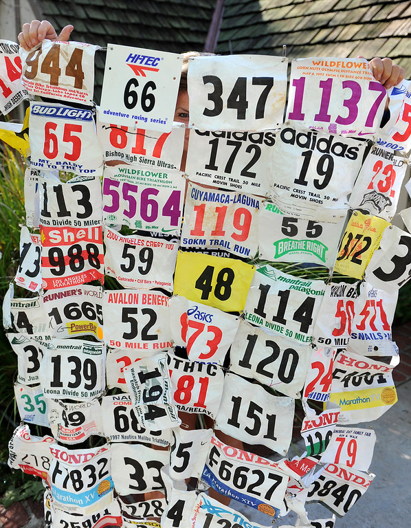 . Shannon Farar-Griefer holds bib numbers from her races. Farar-Griefer, who has multiple sclerosis, will run 135 miles from Upper Las Virgenes Canyon Open Space Preserve to Barstow as part of an MS  fund raiser event, MS Run the US.  (Photo by Michael Owen Baker/L.A. Daily News)