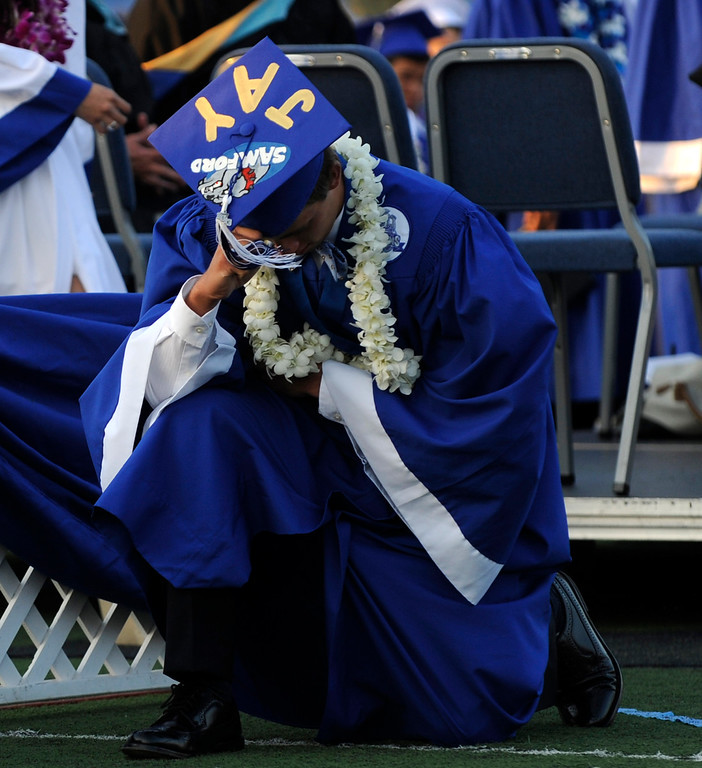 . A graduate celebrates after receiving his diploma during the San Marino High School commencement at San Marino High School on Friday, June 7, 2013 in San Marino, Calif.