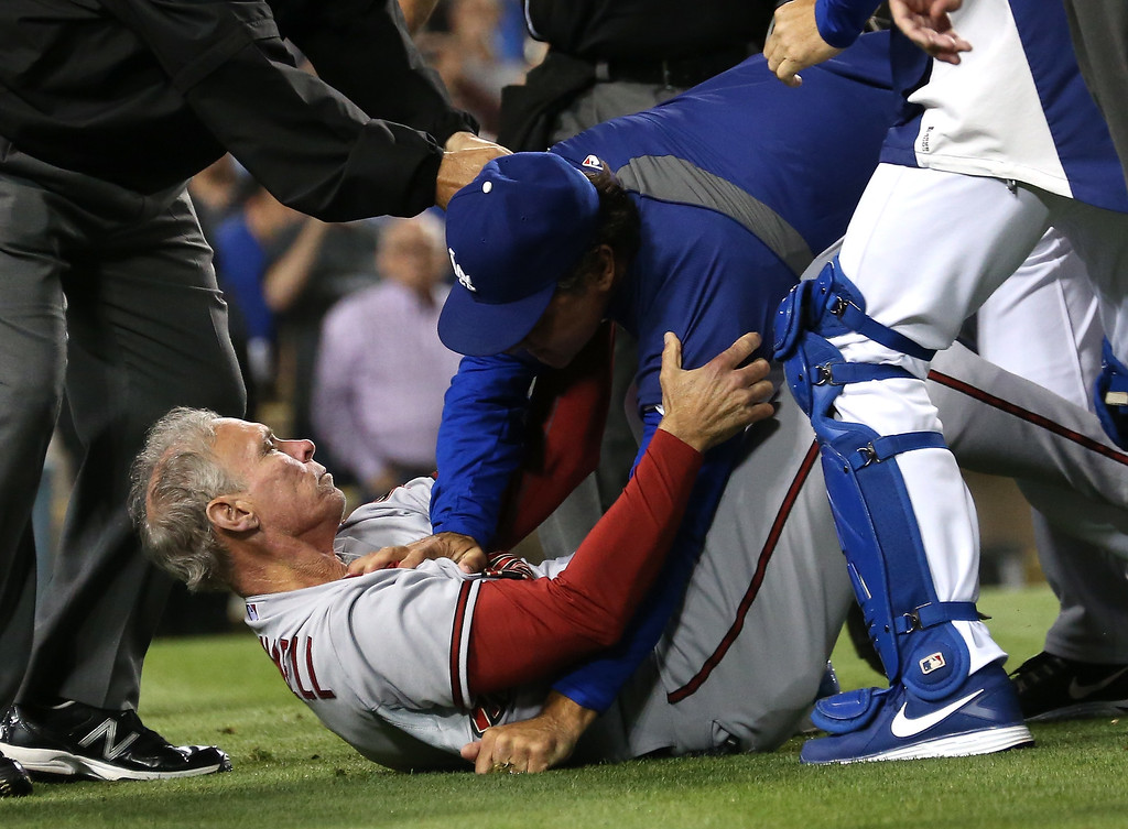 . LOS ANGELES, CA - JUNE 11:  Manager Don Mattingly (R) of the Los Angeles Dodgers pushes down coach Alan Trammell #3 of the Arizona Diamondbacks during a bench clearing brawl in the seventh inning at Dodger Stadium on June 11, 2013 in Los Angeles,  (Photo by Stephen Dunn/Getty Images)