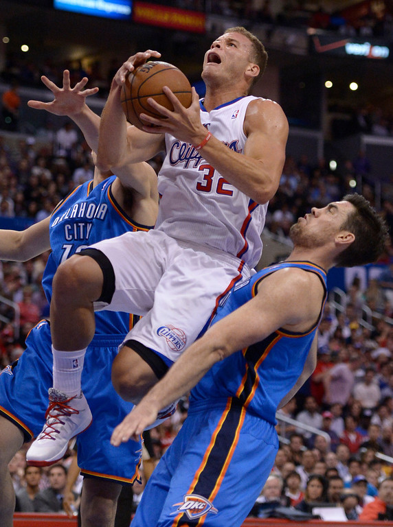 . Clippers#32 Blake Griffin is fouled on his way to the hoop by Thunder#4 Nick Collison in the first quarter. The Los Angeles Clippers played the Oklahoma City Thunder in a regular season game at Staples Center in Los Angeles, CA. 4/9/2014(Photo by John McCoy / Los Angeles Daily News)