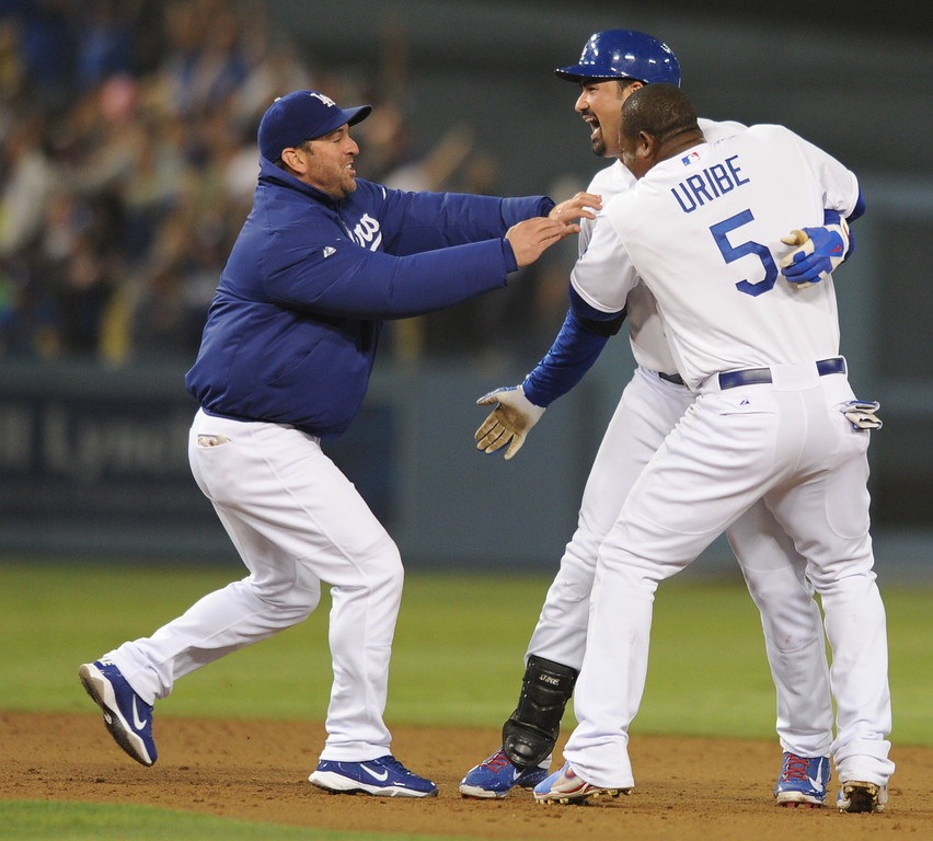 . Adrian Gonzalez celebrates after his double to win the game. The Dodgers defeated the New York Mets 5-4 in 12 innings at Dodger Stadium in Los Angeles, CA. 8/13/2013(John McCoy/LA Daily News)