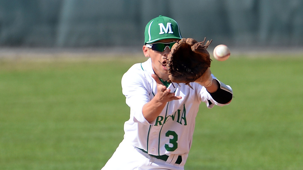 . Monrovia second baseman Devin Ayala makes the play on Alhambra\'s James Giambalvo (not pictured) in the first inning of the Arcadia Elk Baseball Tournament at Monrovia High School in Monrovia, Calif., on Thursday, March 13, 2014. Monrovia won 2-0.  (Keith Birmingham Pasadena Star-News)
