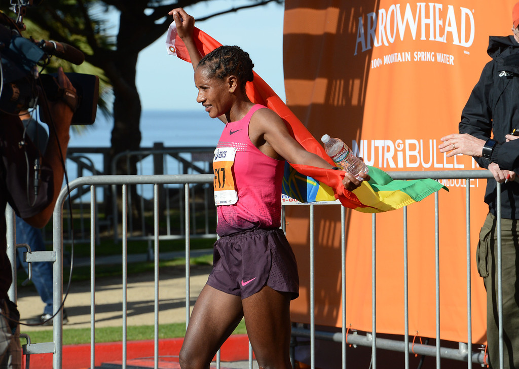 . 2014 ASICS LA Marathon women\'s winner Amane Gobena of Ethiopia, celebrates after she crossed the finish line in Santa Monica Calif, with a time of 2: 27:37.   Sunday, March 9,  2014.   (Photo by Stephen Carr / Daily Breeze)