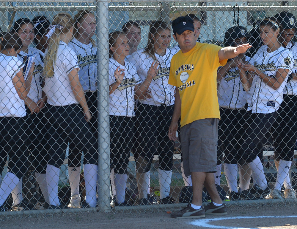 . Peninsula assistant coach Roman Hernandez talks to the team as Arroyo Grande brings in a new pitcher in a CIF Southern Section Division III wild-card softball game in Rolling Hills Estates Tuesday. Peninsula won the game 13-0. 20130514 Photo by Steve McCrank / Staff Photographer