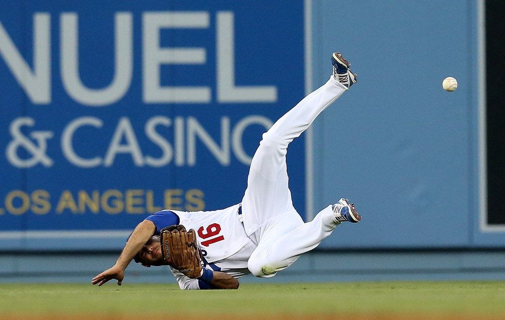 . Center fielder Andre Ethier #16 of the Los Angeles Dodgers dives but can\'t come up with a single hit by Miguel Montero of the Arizona Diamondbacks in the fourth inning at Dodger Stadium on June 12, 2013 in Los Angeles, California.  Diamondbacks won 8-6.   (Photo by Stephen Dunn/Getty Images)