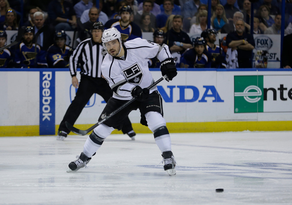 . Los Angeles Kings\' Drew Doughty passes the puck during the first period in Game 5 of a first-round NHL hockey Stanley Cup playoff series against the St. Louis Blues, Wednesday, May 8, 2013, in St. Louis. (AP Photo/Jeff Roberson)