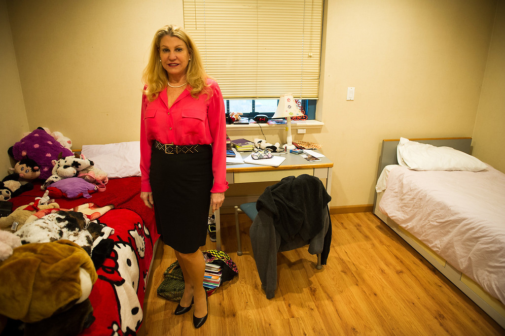 . Lois Lee stands in a dorm room at Children of the Night in Van Nuys. Monday, March 17, 2014. (Photo by Michael Owen Baker/L.A. Daily News)