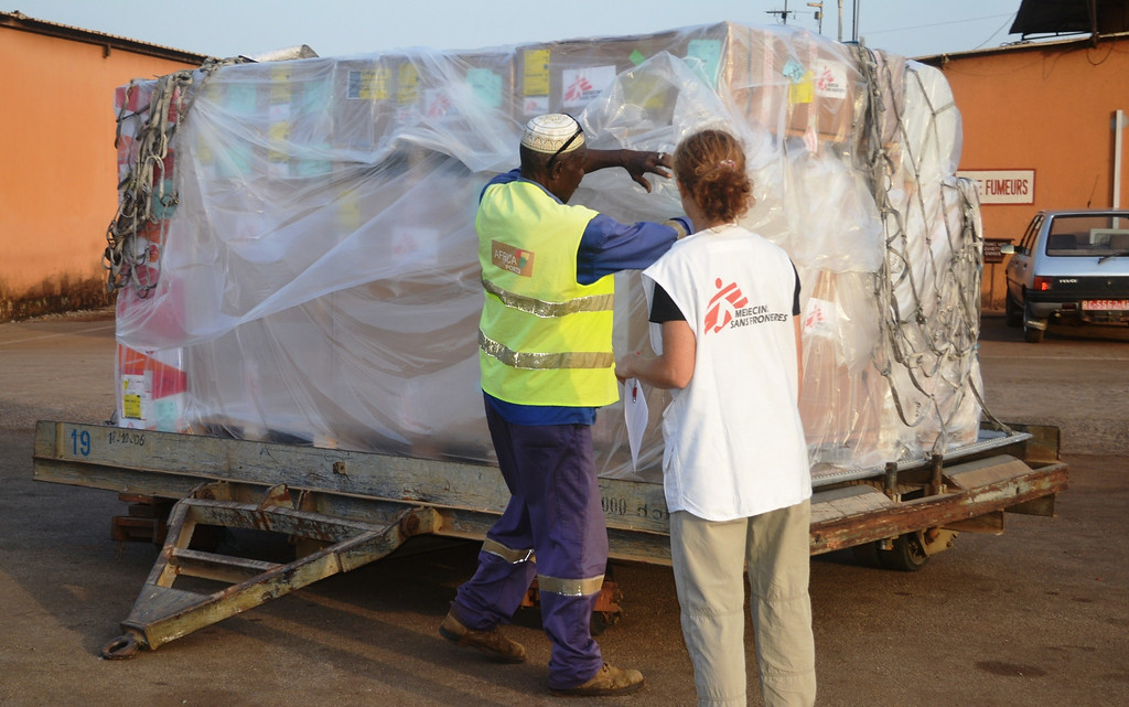 . A worker loads material including protection gear for the NGO Medecins sans Frontieres (Doctors without borders-MSF) at the airport of Conakry on March 29, 2014. Guinea raced Saturday to contain a deadly Ebola epidemic spreading from its southern forests to the capital Conakry, as neighbouring Senegal closed its border.          (CELLOU BINANI/AFP/Getty Images)