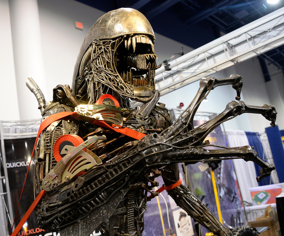 . Nov 6,2013 Las Vegas NV. USA. Quickloader the retractable tied down  straps hold down a life size Alien made out of auto parts, during the second day of the 2013 SEMA auto show.