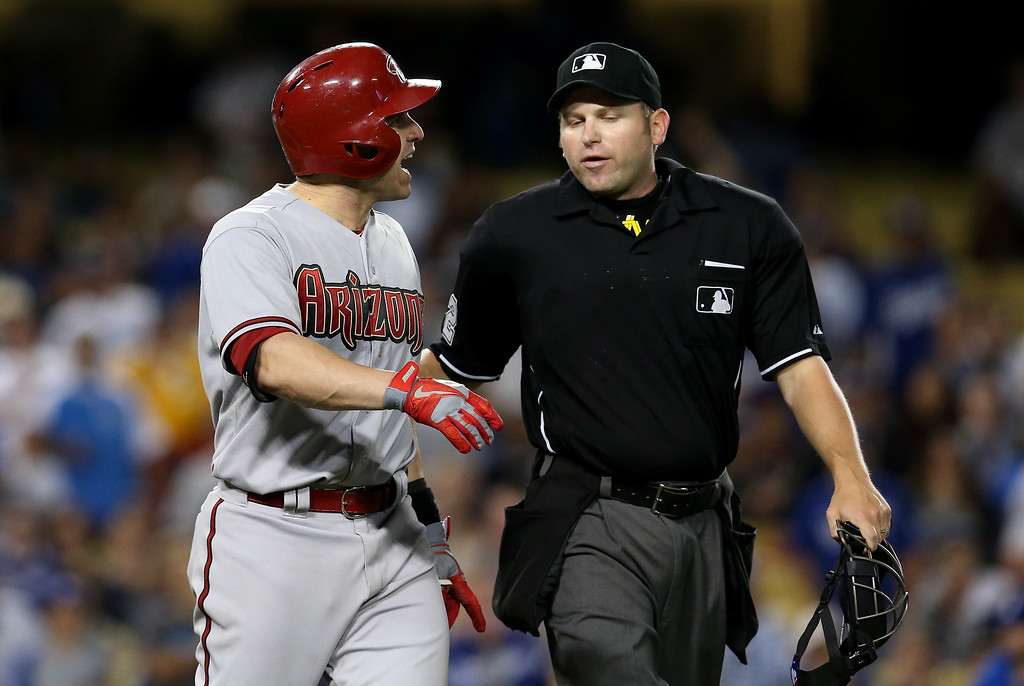 . LOS ANGELES, CA - JUNE 11: Miguel Montero #26 of the Arizona Diamondbacks talks with home plate umpire Clint Fagan after Montero was hit by a ptich in the seventh inning the Los Angeles Dodgers at Dodger Stadium on June 11, 2013 in Los Angeles,  (Photo by Stephen Dunn/Getty Images)