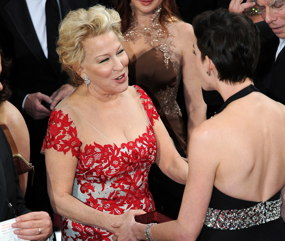 . Bette Midler and Anne Hathaway attend the 86th Academy Awards at the Dolby Theatre in Hollywood, California on Sunday March 2, 2014 (Photo by John McCoy / Los Angeles Daily News)