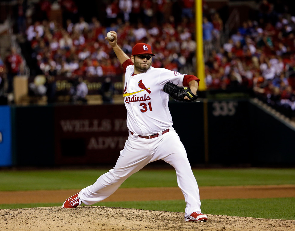 . St. Louis Cardinals\' Lance Lynn throws during the 13th inning of Game 1 of the National League baseball championship series against the Los Angeles Dodgers Saturday, Oct. 12, 2013, in St. Louis. (AP Photo/David J. Phillip)