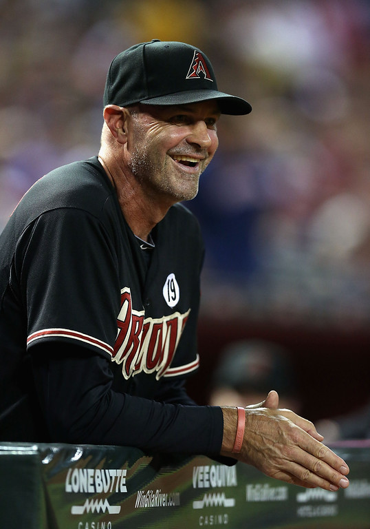 . PHOENIX, AZ - JULY 10:  Manager Kirk Gibson #23 of the Arizona Diamondbacks smiles in the dugout during the MLB game against the Los Angeles Dodgers at Chase Field on July 10, 2013 in Phoenix, Arizona.  (Photo by Christian Petersen/Getty Images)
