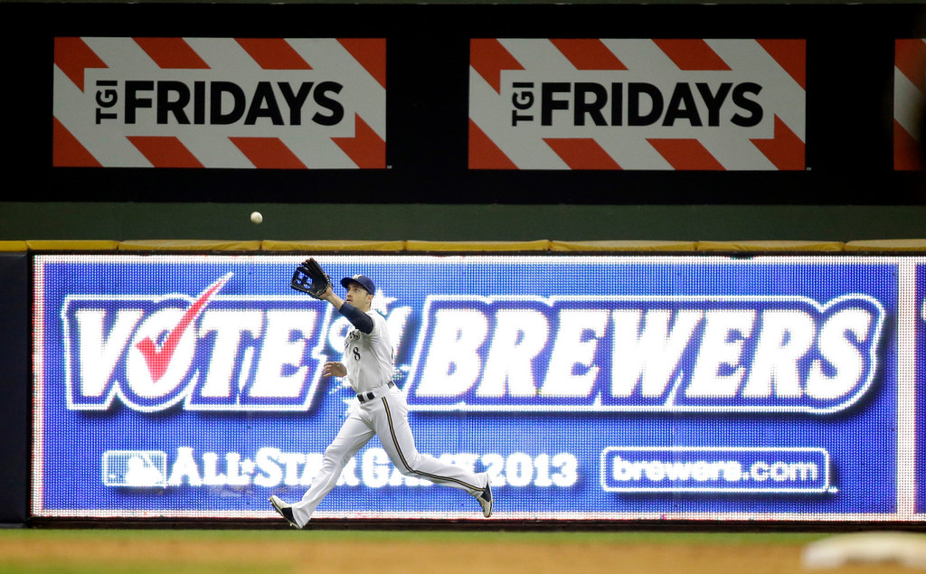 . Milwaukee Brewers\' Ryan Braun makes a catch during the fifth inning of a baseball game against the Los Angeles Dodgers Tuesday, May 21, 2013, in Milwaukee. (AP Photo/Morry Gash)