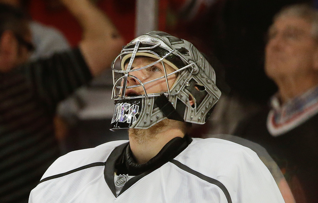 . Los Angeles Kings goalie Jonathan Quick watches a replay after the Chicago Blackhawks scored a goal in the second period of Game 1 of the NHL hockey Stanley Cup Western Conference finals, Saturday, June 1, 2013, in Chicago. (AP Photo/Nam Y. Huh)