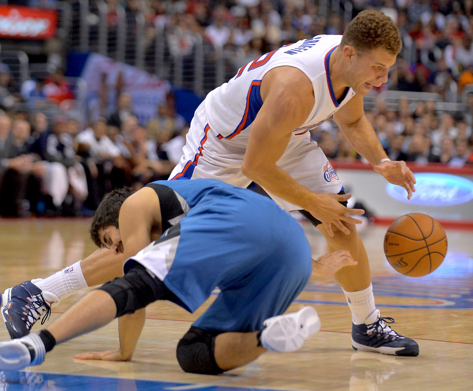 . Los Angeles Clippers\' Blake Griffin grabs a loose ball as Ricky Rubio hits the floor Monday, Nov. 11, 2013, in Los Angeles.  The Clippers won the game 109-107.(Andy Holzman/Los Angeles Daily News)