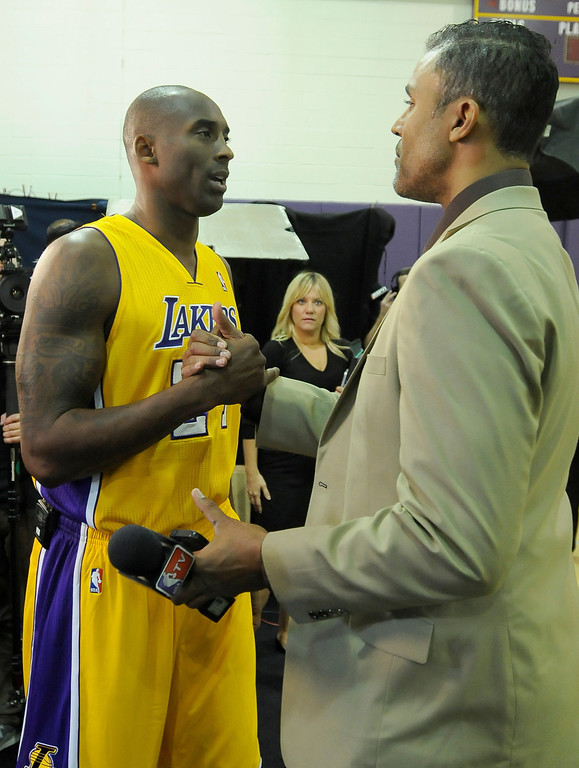 . Kobe Bryant shakes hands with his old teammate and current NBA TV reporter Rick Fox. The Los Angeles Lakers held a media day at their El Segundo practice facility. Players were photographed for team materials, and interviewed by the press. El Segundo, CA. 9/27/2013. photo by (John McCoy/Los An8eles Daily News)