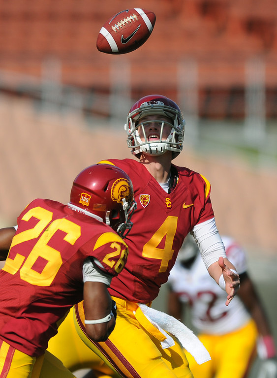 . USC QB Max Brown mishandles the snap during their spring game, Saturday, April 19, 2014, at the Coliseum. (Photo by Michael Owen Baker/L.A. Daily News)