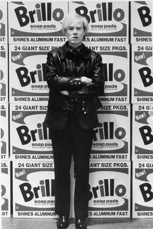 ". Artist Andy Warhol is pictured with his series of prints titled ""The Brillo Boxes\"" at the Tate Gallery in London, Feb. 15, 1971. (AP Photo/Press Association)"