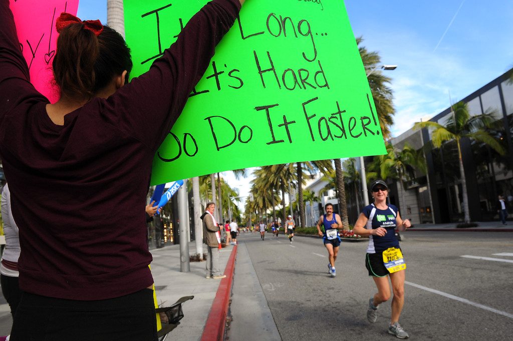 . Karla Mendoza, of Chino, holds a sign for runners in Beverly Hills during the Los Angeles Marathon, Sunday, March 9, 2014. (Photo by Michael Owen Baker/L.A. Daily News)